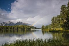 Rainbow on Two Jack Lake Banff National Park Canadian Rockies Alberta Province - stock photo