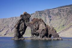 Las Playas Bay with the rock arch Roque de Bonanza El Hierro Canary Islands - stock photo