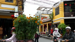 Traffic and tourism in the old town of Hoi An Vietnam Stock Footage