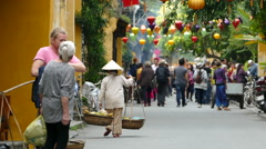 Big group Asian tourists walking in the old town of Hoi An Vietnam Stock Footage