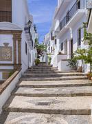 White houses in narrow alleyway Frigiliana Costa del Sol Andalucia Spain Europe Stock Photos