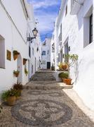White houses in narrow alleyway Frigiliana Costa del Sol Andalucia Spain Europe Stock Photos