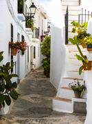 White houses in narrow alleyway Frigiliana Costa del Sol Andalucia Spain Europe - stock photo