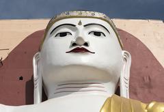 Face of a Buddha statue Four Seated Buddha Shrine at Kyaikpun Pagoda in Bago - stock photo