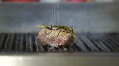 Beef steak is grilling at restaurant kitchen Stock Footage