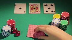 Happy poker player checking cards, showing thumbs-up hand sign, lucky game Stock Footage