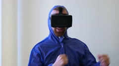 Funny moment. man laughs and dances in a virtual reality helmet Stock Footage