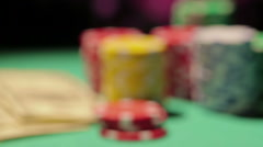 Gambling fraud, gamer catches royal flush, dollar bills, pile of chips on table Stock Footage