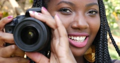 Young Afro Brazilian taking photos with a professional camera Stock Footage