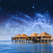 Villa cottages on Maldives. Elements of this image furnished by NASA - stock photo