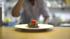 Cook presenting ready dish, beef steak with vegetables Stock Footage