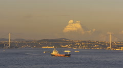 Sunset freighter ferries bridge over Bosphrus Strait Istanbul Turkey - stock footage