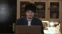 Young Entrepreneur Freelancer Working using a Laptop and in Coworking Stock Footage