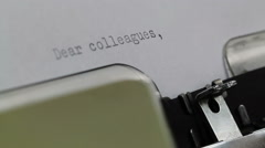 Typing Dear Colleagues on Typewriter - stock footage