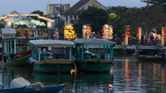 Boats with the Cau An Hoi bridge at the background in Hoi An Vietnam Stock Footage