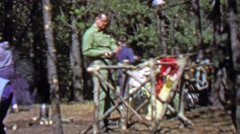 1967: Survivalist natural made living 12th World Scout Jamboree. Stock Footage