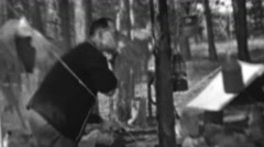 1967: Man clean shaving outdoors campsite 12th World Scout Jamboree. Stock Footage