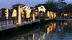 The Cau An Hoi bridge in the evening with Floating lanterns Stock Footage
