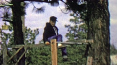 1962: Thug black hooded kid hanging monkey bars outdoor park. Stock Footage