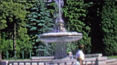 1962: Water fountain at public park visited by family. Stock Footage