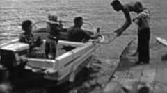 1962: Powerboat landing family helps dock safely. Stock Footage