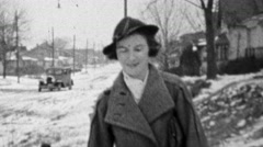 1938: Mother taking children snowy old timey streets. Stock Footage