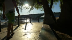 A couple walking along the canal in Lake Havasu City, AZ Stock Footage