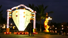 People walk around a big lantern next to the thu bon river side Stock Footage