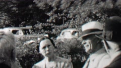 1939: Gangster men fedora hats visit innocent family midday sunshine. Stock Footage