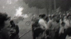 1939: Crowd lookiloos gathers to watch the burning small town building. Stock Footage