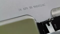 Typing We are on vacation on Typewriter - stock footage