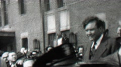 1939: Politician handsome man cheered by the adoring crowd. - stock footage