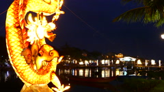 Dragon statue with the Cau An Hoi bridge at night Stock Footage