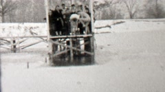 1939: Polar bear club jumping into frozen ice cold lake water. Stock Footage