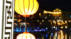 Close up from red lanterns at night on the Cau An Hoi bridge Stock Footage