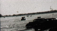 1939: Car driving on frozen lake sliding drift driving on ice surface. Stock Footage