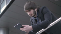 Man with Tablet PC Chatting, Young Business Man in Airport. Casual urban Stock Footage