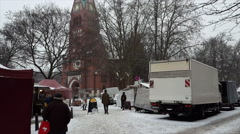 Farmer market at Karl August Platz church square, snow day, Berlin, Germany Stock Footage