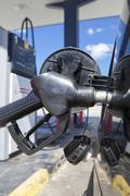 Car refueling on a petrol station. Nozzle detail Kuvituskuvat