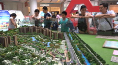 China middle class, people look at model homes, real estate agents Stock Footage