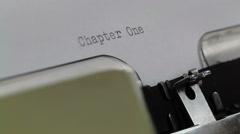 Typing Chapter One - message intro Typewriter close up - stock footage