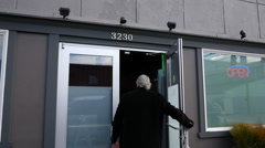 Man Walks Into Marijuana / Cannabis Shop Stock Footage