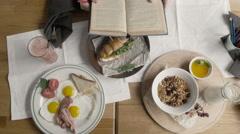 Top Healthy Breakfast of Oatmeal Porridge, Eggs, Granola, Juice, Bacon, Nuts in - stock footage