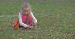 Girl Tries to Construct a Tower of Wooden Sticks Stock Footage