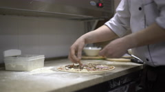 Chef putting meat on his pizza base Stock Footage