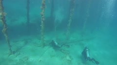Divers visiting the pier under water, Red sea, Marsa Alam, Egypt Stock Footage