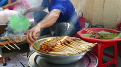 Preparing the Pork skewer/ grilled pork wrapped in rice paper and vegetables Stock Footage
