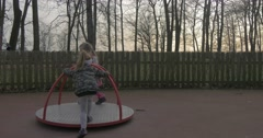 Little Girls Play on Swing in Day of Children Stock Footage