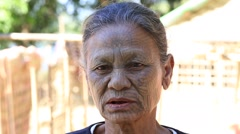 Portrait Chin woman with spider tattoo .  Mrauk U, Myanmar. Burma Stock Footage