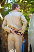 Handyman with tool belt around waist Stock Photos